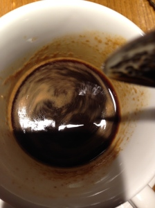 coffee being stirred in a mug