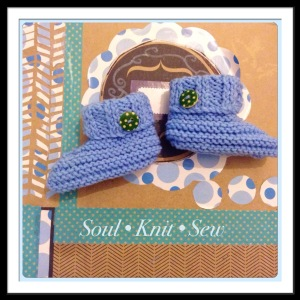 knitted baby booties with green buttons