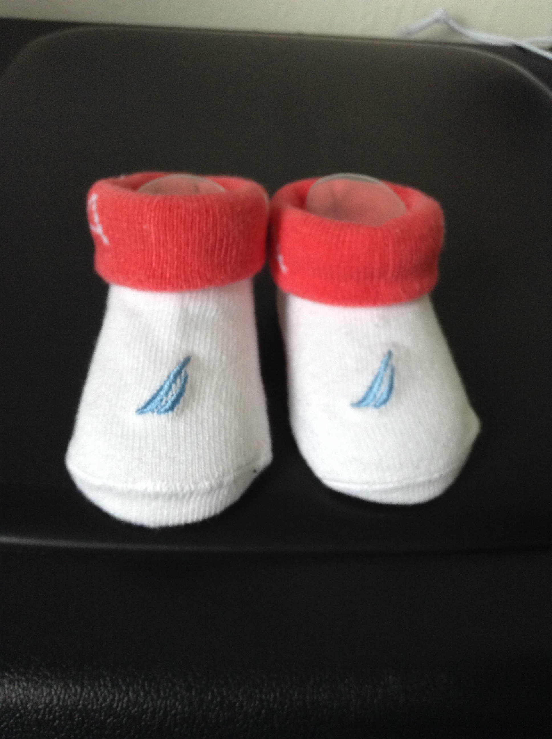 picture of white baby socks with red trimming